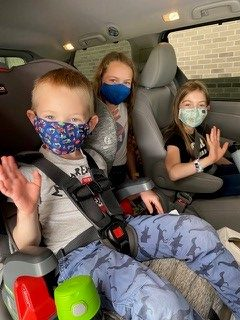 Children in car with masks